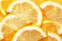 Orange and lemon slices background Stock Images