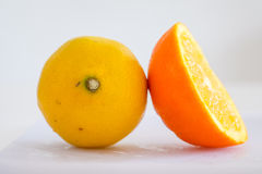 Orange and lemon in white background Royalty Free Stock Images
