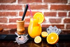 Orange lemonade as summer drink, nonalcoholic refreshment. Orange lemonade as fresh summer drink, nonalcoholic refreshment Stock Photos