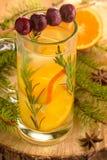 Orange lemonade with cherry and rosemary Stock Photos