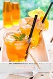 Orange lemonade. Refreshing lemonade with oranges and mint on wooden table royalty free stock photos