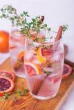 Orange Lemonade With Thyme, Cinnamon, Ice And Honey Stock Photography