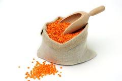 Orange lentils in a bag Stock Photo