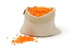 Orange lentils in a sack Royalty Free Stock Photo