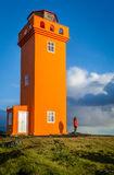Orange Leuchtturm Stockfotografie