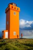 Orange Leuchtturm Stockfotografie