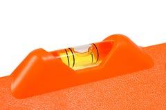 Orange Level. Bubble Level in orange Isolated on white background Stock Images