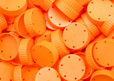 Orange lid of plastic bottles talcum powder Stock Photos