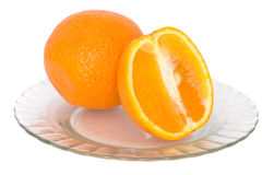 Orange. Lies in plates, on a white background Royalty Free Stock Photos