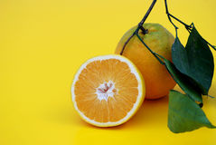 Orange in Life. Healthy and tasty Orange in Life on yellow background Stock Images
