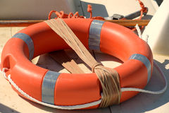 The orange life belt (buoy ring)on the sea beach Royalty Free Stock Image