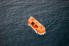 Orange life boat royalty free stock image