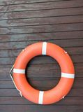 Orange life buoy belt for saftey. In the water and swimming pools Stock Image