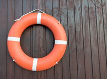 Orange life buoy belt for saftey. In the water and swimming pools Stock Photo
