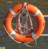 Orange life buoy Royalty Free Stock Images