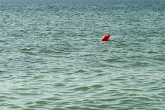 Orange Life Buoy In The Middle Of The Ocean Royalty Free Stock Photo