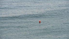 Orange Life Buoy On Ocean stock video