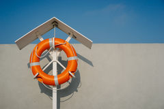 Orange life buoy Royalty Free Stock Photos