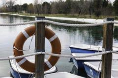 Orange life buoy on the pier Royalty Free Stock Images