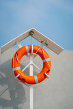 Orange life buoy on the pier. Vintage film look stock photo