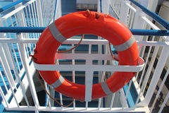 Orange life buoy on the railing of a ship Stock Photo
