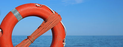 Orange life buoy for the rescue people Stock Photography