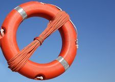 Orange life buoy for the rescue of persons Stock Photos