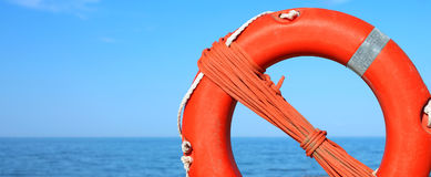 Orange life buoy for the rescue of persons Stock Photo