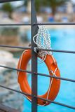 Orange life buoy with rope near the pool hanging on the bridge stock photos