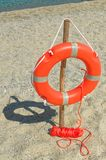 Orange Life Buoy on the sandy beach. Riaci. Riaci beach is located near Tropea, Italy royalty free stock images