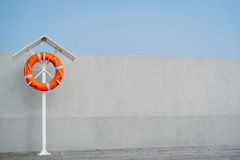 Orange life buoy. On the Sopot pier royalty free stock photos