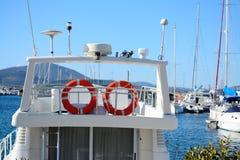 Orange life buoys on a white boat Stock Photos