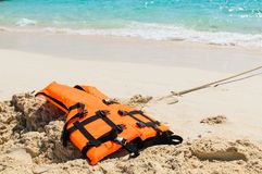Orange life jacket on the beach Stock Photo