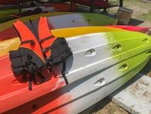 Orange Life jackets and kayak boat. At thailand royalty free stock image