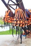 Orange life jackets and pool. Royalty Free Stock Photos