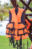 Orange life jackets and pool. Royalty Free Stock Image