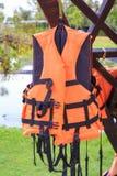 Orange life jackets and pool. Royalty Free Stock Image