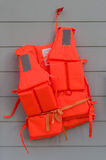 Orange life jackets Stock Images