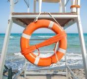 Orange life preserver on a beach Royalty Free Stock Photography