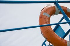 Orange life ring on ship deck against the sky Royalty Free Stock Photography