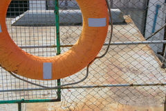 Orange life ring on ship deck Royalty Free Stock Photography