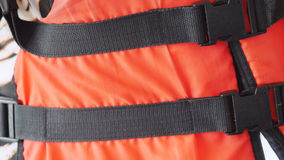 Orange life safety jacket Stock Photo