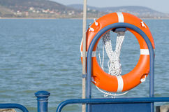 Orange Lifebelt with Rope Stock Images