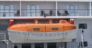 Orange lifeboat on a cruise ship Royalty Free Stock Photography