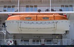 Orange lifeboat on a cruise ship Royalty Free Stock Photo