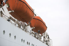 Orange lifeboat on vessel Royalty Free Stock Photos