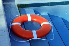 Orange Lifebuoy. A bright orange lifebuoy in a south Florida swiming pool Stock Images