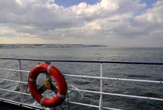 Orange Lifebuoy. On the boat Royalty Free Stock Photography