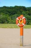Orange lifebuoy on the beach Stock Photo