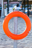 Orange lifebuoy. Equipment for rescue of people. Service for lifesaving Royalty Free Stock Photography